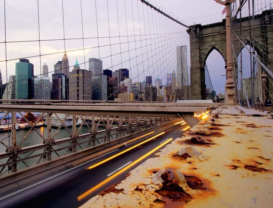 Brooklyn bridge corrosion with skyscraper skyline