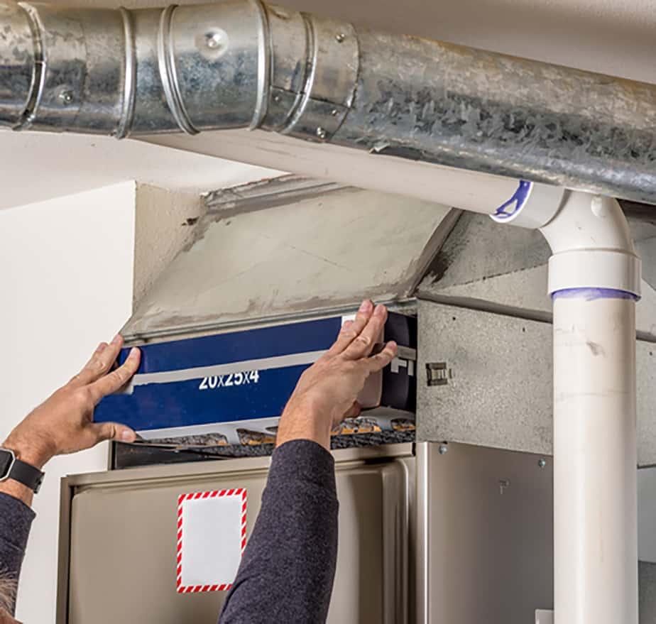 Changing furnace filter inside home