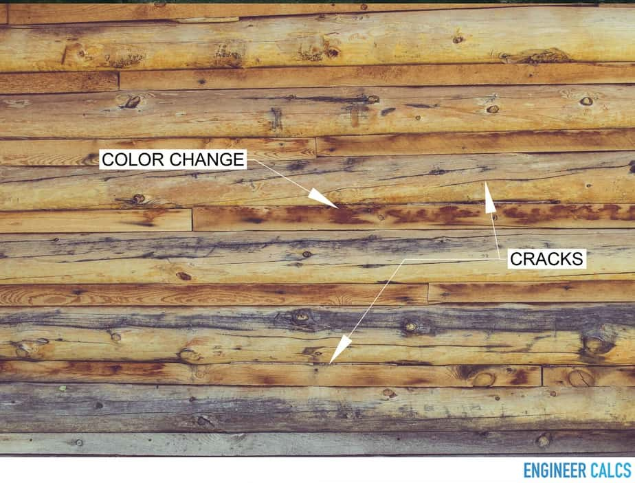 Exterior wood wall cracks and discoloration