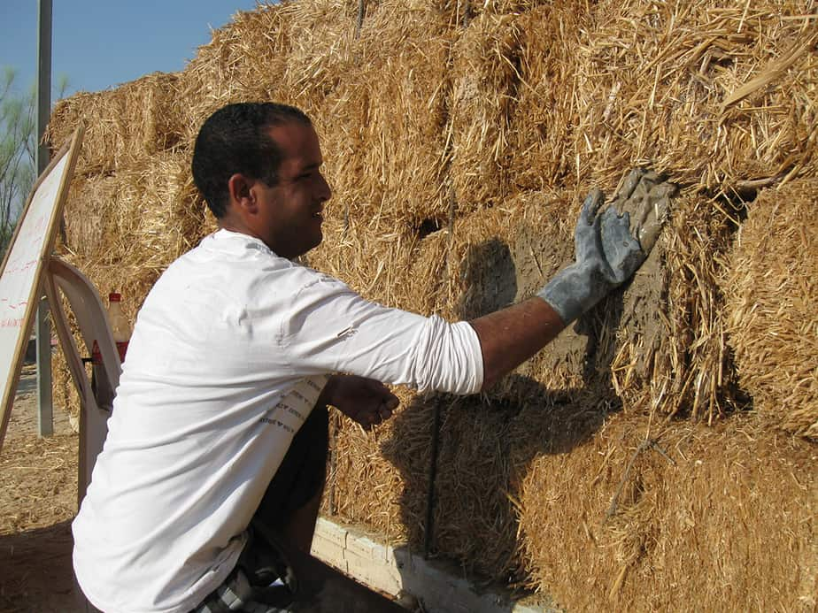 Straw bale for insulating home foundation
