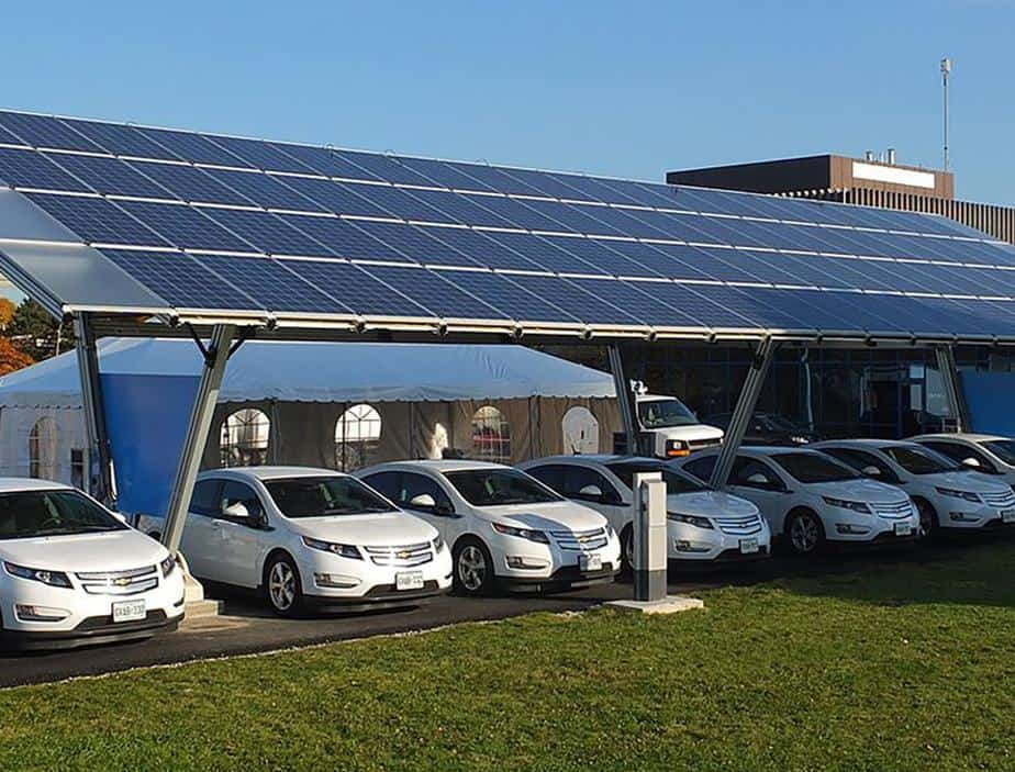 Electric cars charging under solar roof