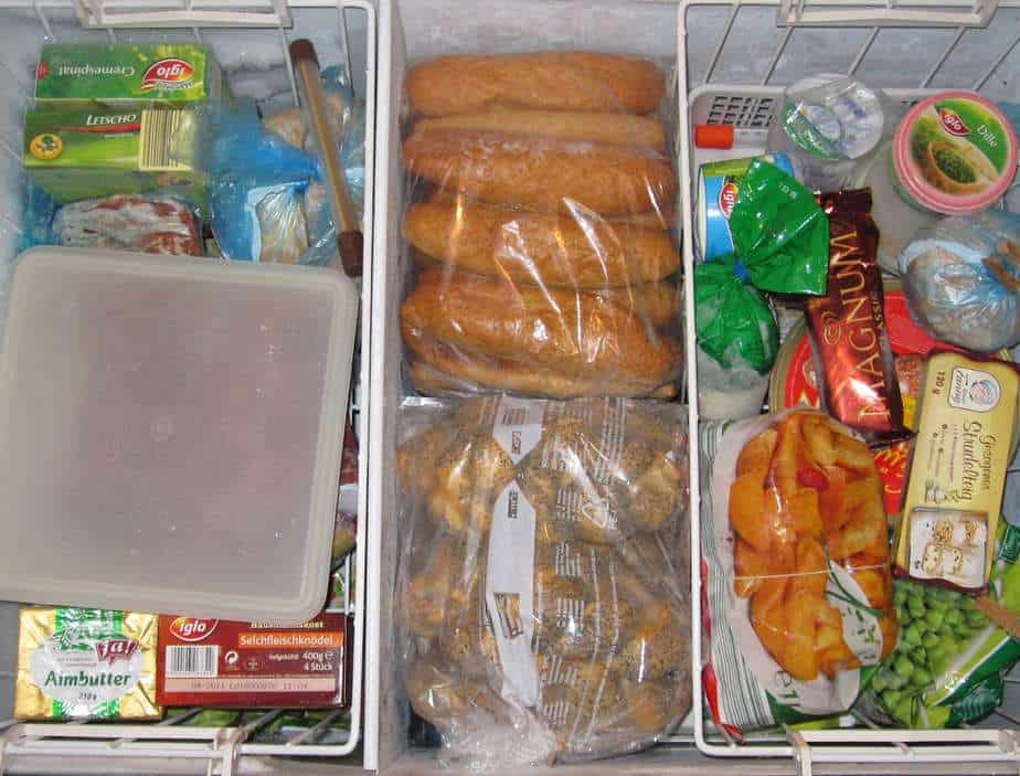 Standalone freezer packed with food