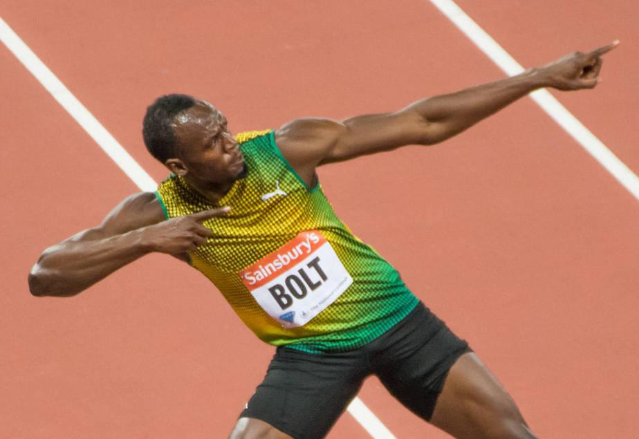 Usain Bolt lightening bolt post after winning olympic race
