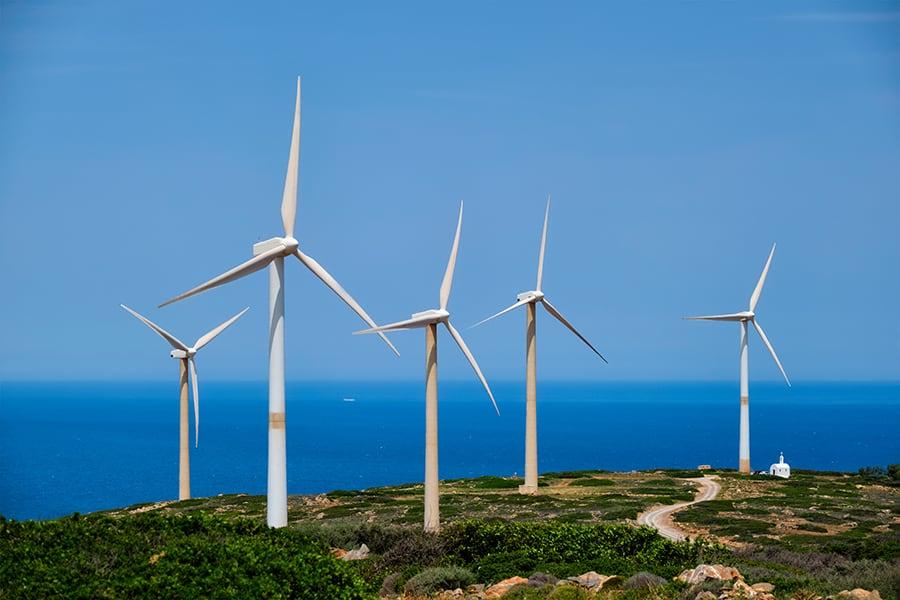green renewable alternative energy wind generator turbines in crete island greece
