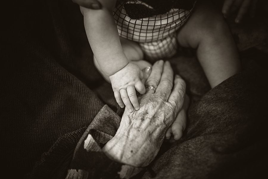 grandma and grandchild holding hands