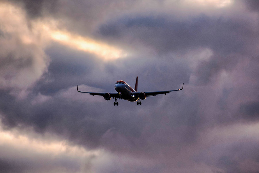 airplane flying in stormy weather